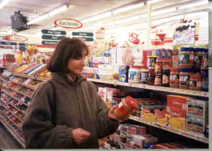 picture of woman reading a food label