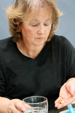 picture of a woman taking medicines